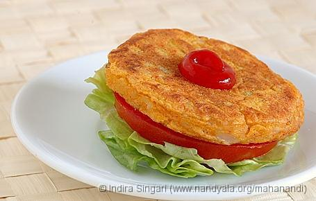 Alu Tikki with a slice of Tomato, Lettuce and Tomato Ketchup
