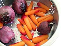 Baby Beets and Carrots in a Steamer Basket