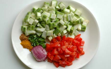 Ridge Gourd, Tomato, Onion, Dhania Powder, Green Chillies and Turmeric