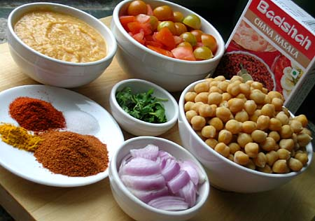 Cooked Chickpeas, tomatoes, pureed chickpea paste, cilantro, onion, red chilli powder, salt, chana masala powder(Badshah brand) and turmeric