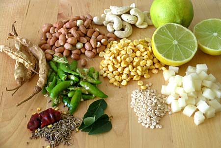 Limes, cashews, peanuts, majjiga mirapakaayalu, vertically slit green chillies, mustard seeds, cumin, red chilli, curry leaves, soaked chana dal, urad dal, cubed potato