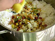 Mixing saut�ed ingredients with rice along with lime juice