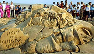 sand sculpture depicting trauma caused by the recent South Asian earthquake