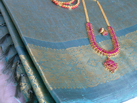Kanchi Pattu Saree and Ruby Necklace