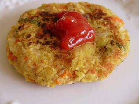 Toordal-Almond burgers with ketchup on top