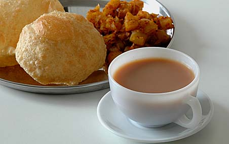 Masala Tea and in the background, our lunch -Puris with Potato Curry