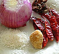 Red Onion, Coconut Powder, Jaggery, Red Chillies and Tamarind - Ingredients for Onion Chutney