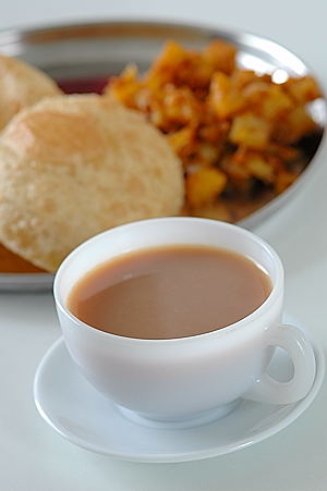 Sonti Tea with Puri and Potato Curry
