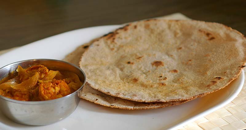 Sorghum roti (Jonna Rotte, Jowar roti) with curry