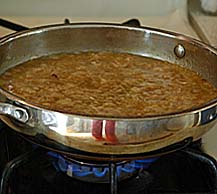 Cooked Rice-Dal Mixture is added to Jaggery Syrup