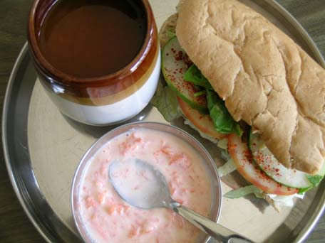 Tomato rasam, yogurt with carrots and sandwich